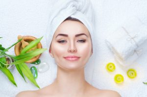 Spa Woman Beauty Treatments. Close-up portrait of beautiful girl